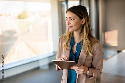 Cuadros en Lienzo Business woman designer working on tablet in office