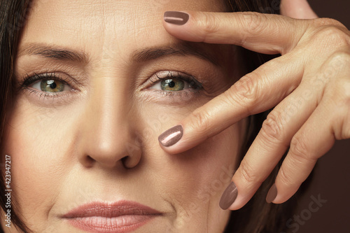 Canvas Beautiful middle aged woman with clean wrinkled skin
