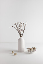 Easter Eggs In Bowl And Willow Bouquet On White Background, Space For Text. Vertical Frame.