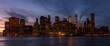 New York city NYC Lower Manhattan Skyscraper skylines building cityscape sunset at dusk from New Jersey. Lower Manhattan is the largest financial district in the world.