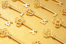 Secret Wealth And The Key To Success Concept With Pattern Of Many Ornate Gold Skeleton Keys Isolated On Golden Background