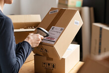 Scanning Parcel Barcode Before Shipment