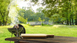 Fototapeta Natura - Wooden desk of free space and summer time in garden with grill