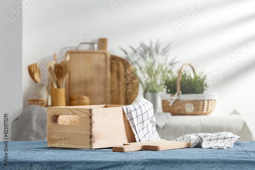 Obraz The kitchen table prepared for breakfast on a beautiful sunny morning  - fototapety do salonu