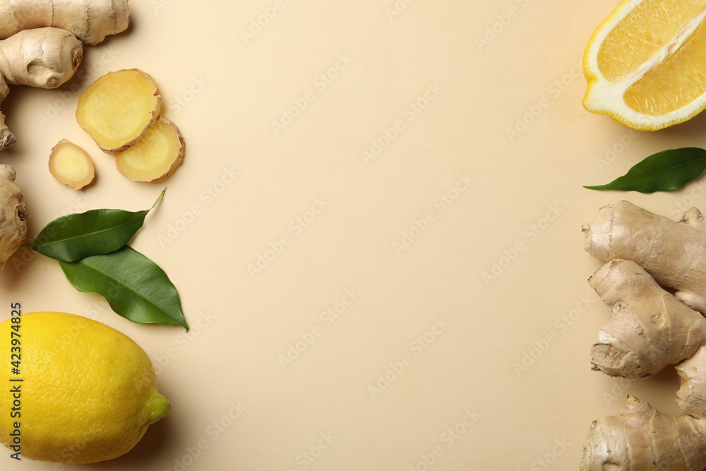 Fototapeta Fresh lemons and ginger on beige background, flat lay. Space for text