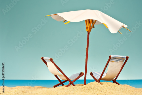 Beach umbrellas and sunbeds on the sand Poster Mural XXL