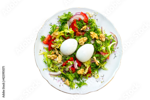 salad with lettuce, eggs,onions,nuts and tomatoes #423993071