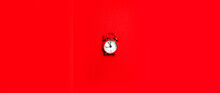 Red Retro Alarm Clock On Red Background With Copy Space. Top View. Flat Lay. Planning Or Working Time Concept