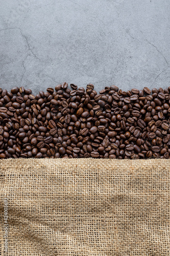 Obraz coffee bean and sack on old cement background. top view. space for text. flat lay - fototapety do salonu