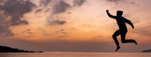 Horizontal Banner Beautiful Seascape At Sunset. Sun Setting Behind A Mountain And Sea With Calm Water Movement.