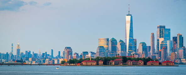 New York, New York, USA skyline from the harbor with Ellis Island