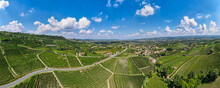 Drone Aerial Panorama Shot Over Barolo Vineyard (vines Fields) In Italy, Unesco Site. Fields With Grape Varieties Used To Produce Barolo Italian Wine, Made From The Nebbiolo Grape.