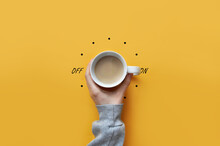 A Cup Of Coffee In Hand And A Light Switch. The Symbol Of The Beginning Of The Day. Turn On Good Morning