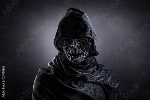Fotografie, Tablou Portrait of a scary figure in hooded cloak