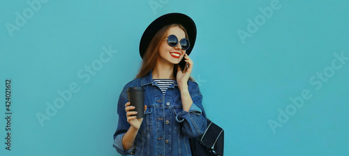 Leinwand Poster Portrait close up of smiling young woman calling on a phone wearing a black roun