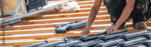 Canvas Print Process of laying the roof by burnt roof tile on the new building or house, buil