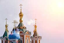 Russian Christian Orthodox Church With Domes And A Cross Against The Sky. Russian Orthodoxy And Christian Faith Concept.