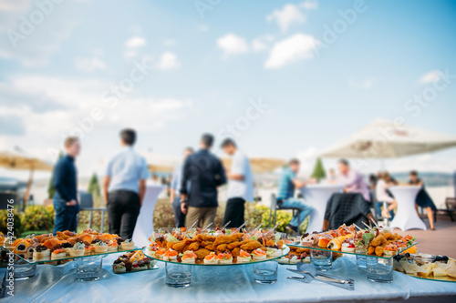Aperitifs at a rooftop party. Fotobehang