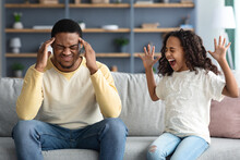 Stubborn Noisy African Child Girl And Annoyed Tired Black Father