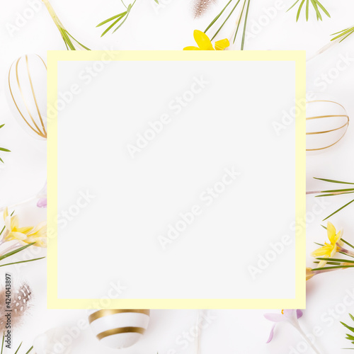 Fototapeta Easter floral background, easter eggs end spring flowers crocus decorated with natural botanical elements, flat lay, blank space for greeting text obraz