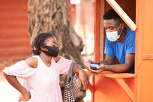 Nigerian Woman Using A Pos Service Kiosk To Withdraw Money, Wearing A Face Mask For Safety