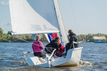 Dad And His Two Daughters Went Out On A Yacht On The River To Sail Along The City And Teach The Girls To Conduct A Sports Yacht.