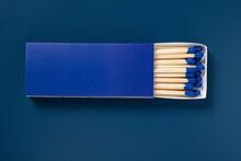 Blue Matchbox And Blue Match Sticks On A Black Background