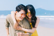 canvas print picture - Young Asian couple enjoying summer vacation on the beach
