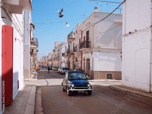 Obraz na plátně Vintage italian car on the street with classic architecture