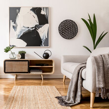 Scandinavian And Design Home Interior Of Living Room With Wooden Commode, Gray Sofa Design Black Lamp, Decoration, Plants And Elegant Accessories. Stylish Home Decor. Mock Up Abstract Paintings.
