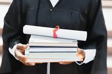 Graduating Student Holding Her Diploma. Close Up