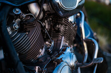 Close-up Of Chrome Parts Of A Motorcycle Outdoors