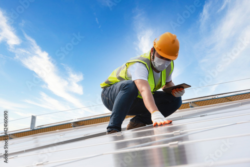 Fotografie, Tablou Male Engineer Inspects Solar Panels on Hospital Building Roofs, Solar Panel Main