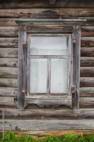 Very beautiful old wooden windows in Slutiski old believers village, Latvia Fotobehang