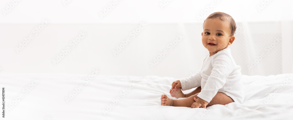 Fototapeta Happy Black Little Baby Girl Sitting In Bedroom At Home