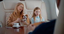 Wealthy Family With Dog Travelling Together By Private Business Plane
