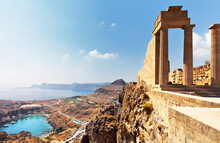 Greece. Rhodes Island. Acropolis Of Lindos. View From The Height Of Ancient Temple Of Athena Lindia IV Century BC To St. Paul's Bay In The Form Of The Heart At Sunny Morning. Mediterranean Travel