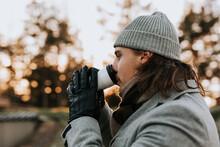 Man Having Drink Outside