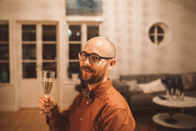 Smiling Man Holding Champagne Flute
