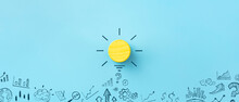 Inspiration, Innovation Concept, Yellow Wooden Cube And Business Strategy On Blue Background