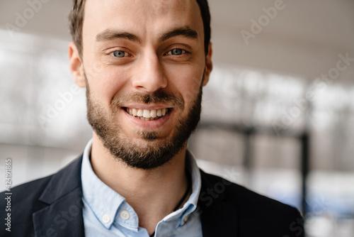 Fototapeta Close up of a smiling mid ages businessman obraz