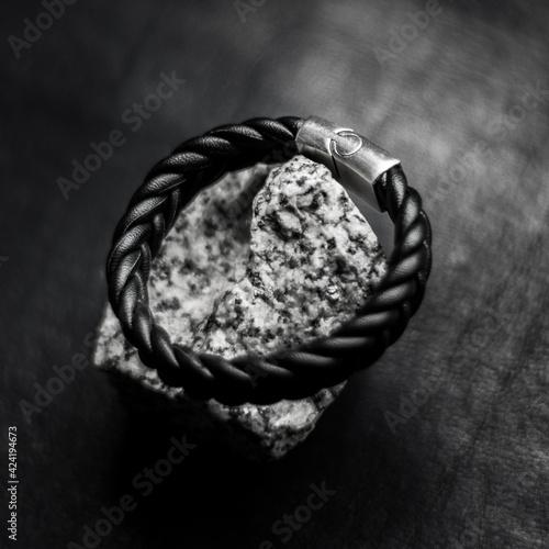 Obraz na plátně leather men bracelet on stone and leather background