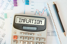 INFLATION Word On Calculator. Business Concept
