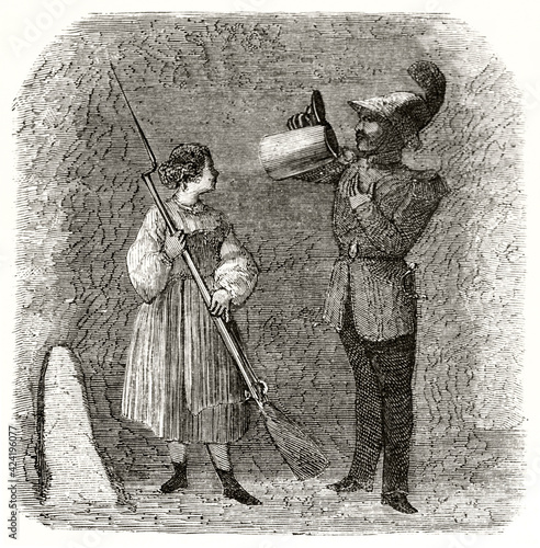 soldier drinking beer from a large mug while a woman hold his rifle with bayonet in Munich Fototapet
