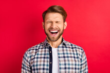 Photo Of Young Excited Handsome Man Happy Positive Smile Humor Joke Laugh Isolated Over Red Color Background