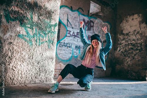 Fotografie, Tablou hipster girl in pink glasses and denim jacket in transition