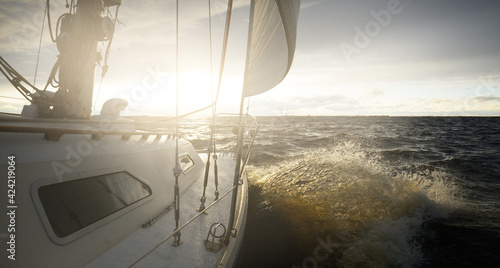 Fotografie, Tablou Yacht sailing in an open sea at sunset