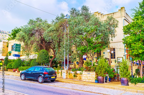 The shady street in German Colony district in Haifa, Israel Fotobehang
