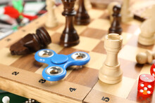 Spinner, Pieces And Dices On Chess Board, Closeup. Tabletop Games