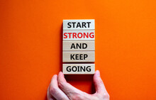Start Strong And Keep Going Symbol. Concept Words 'Start Strong And Keep Going' On Wooden Blocks On A Beautiful Orange Background. Businessman Hand. Business, Motivational And Start Strong Concept.